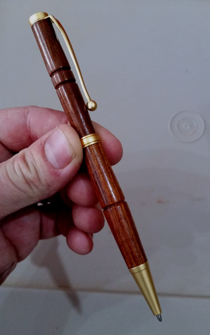 Finished wooden pen made in our workshop as part of our vocational training program