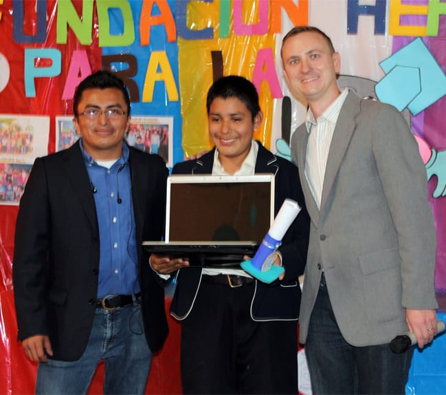 Giving a computer to one of our top students from Colonia Santa Fe
