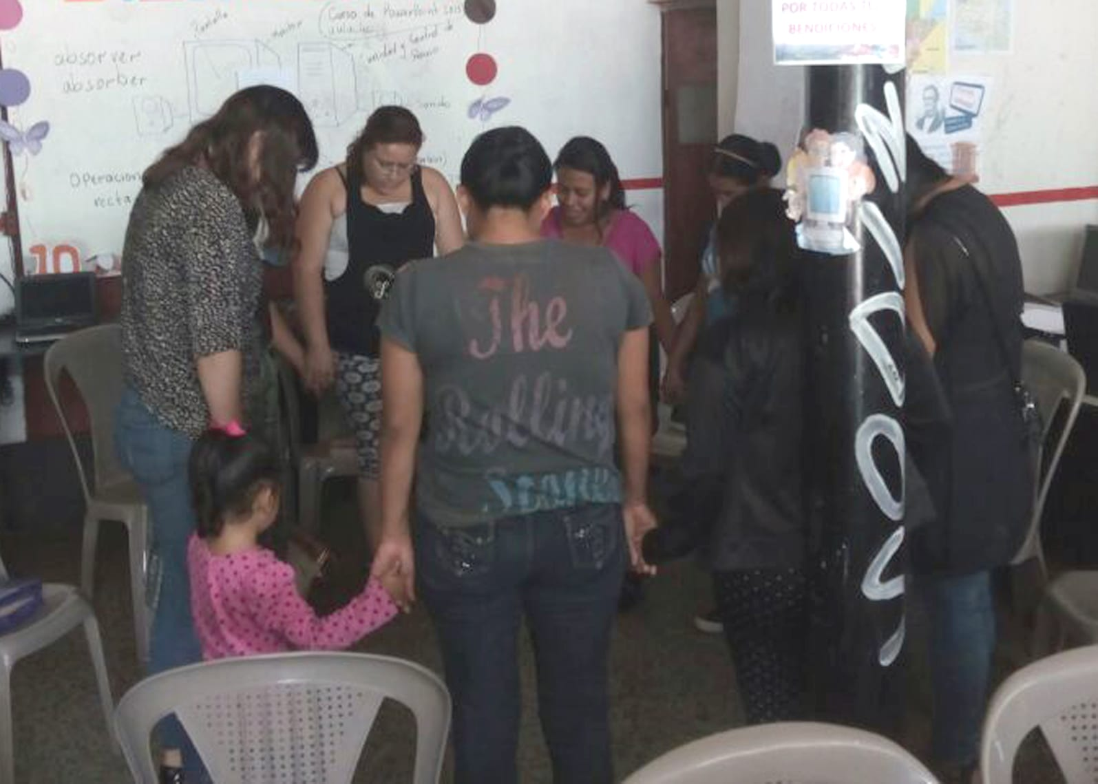 Sharie leading the women's bible study group in prayer