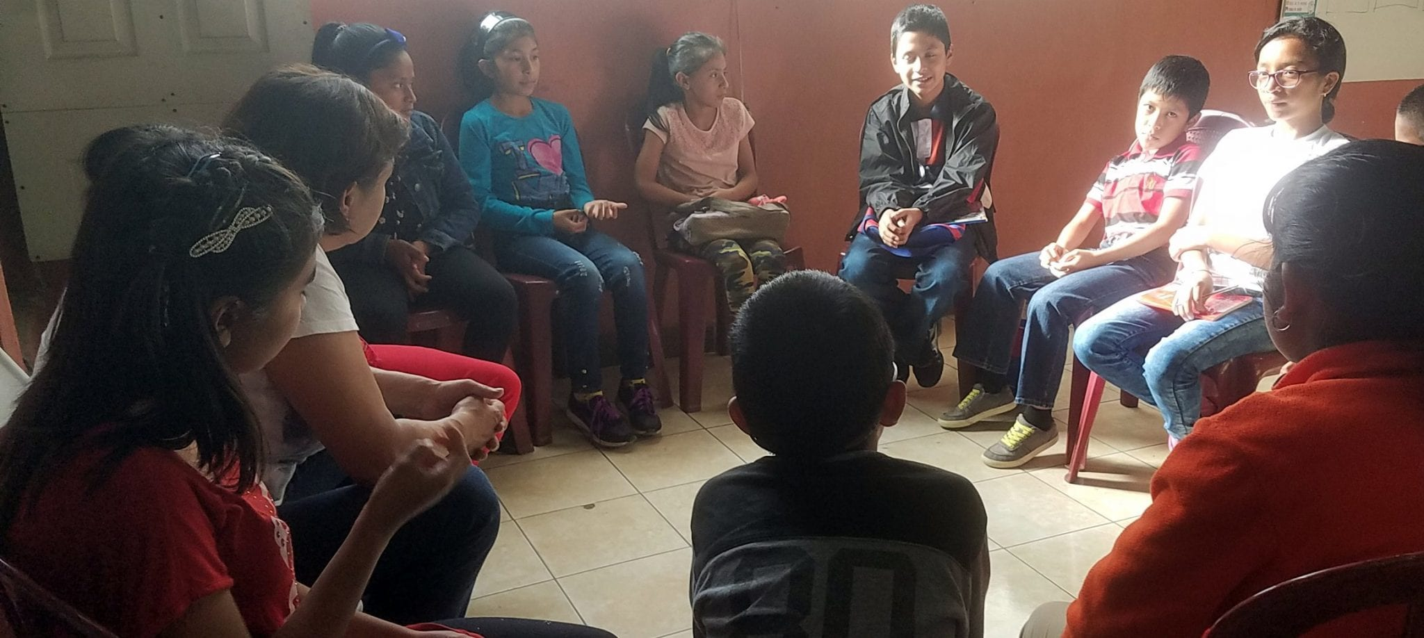 Lucy teaching students at our community center in colonia santa fe